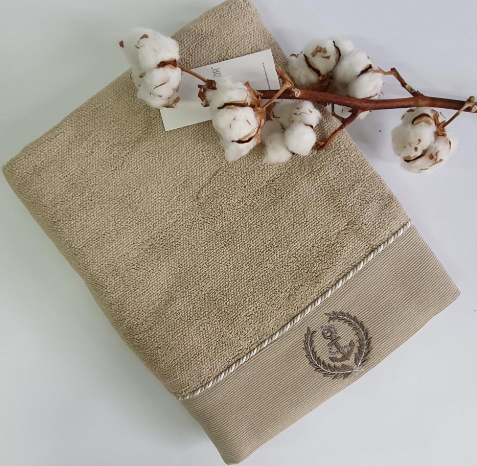 Полотенце и цветы хлопка